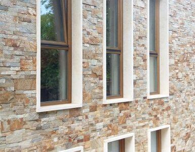 ferestre din lemn stratificat cu geam termopan , placare cu piatra naturala . imagine model 1045